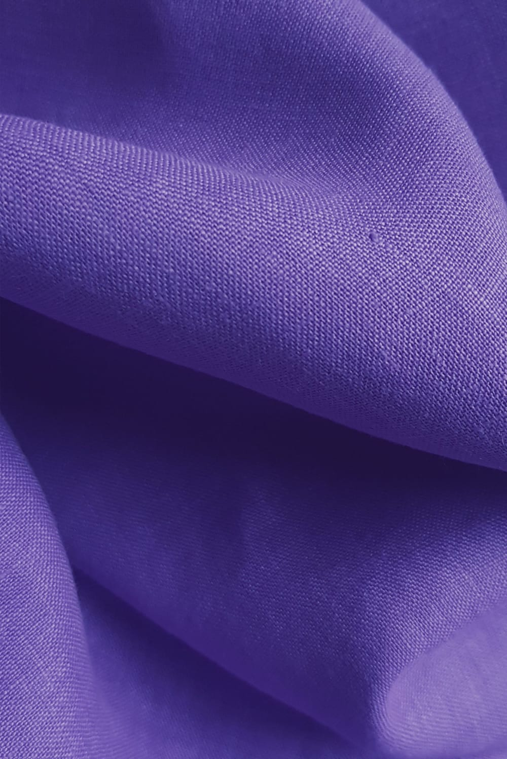 close up of cut couture linen hand dyed with Dylon deep violet