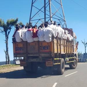 Men wearing white on lorry