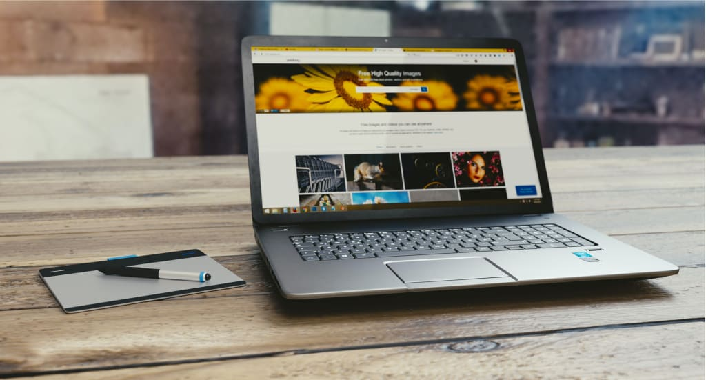 A website builder page shown on a laptop