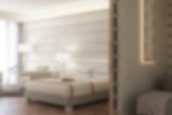 Кровать и гостиная в Exclusive Suite (номер люкс Эксклюзив) отеля Lefay Resort & SPA Lago di Garda