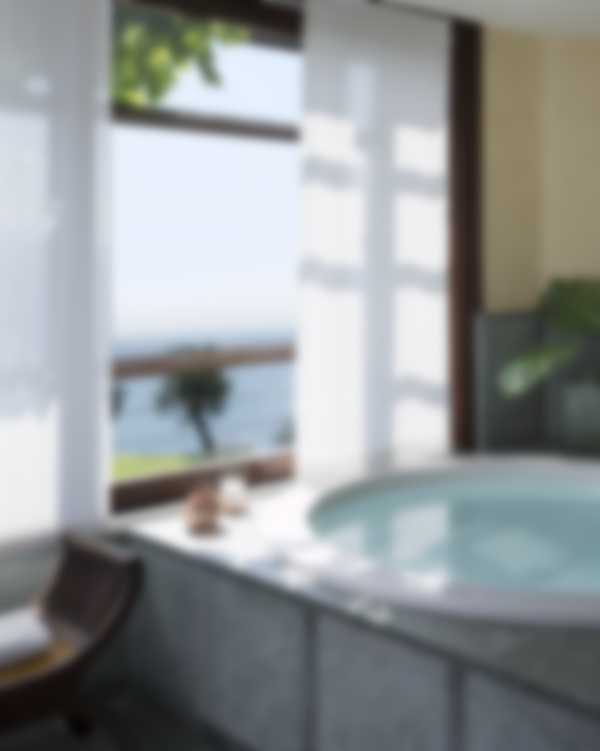 Jacuzzi with lake view from the Exclusive Suite bathroom