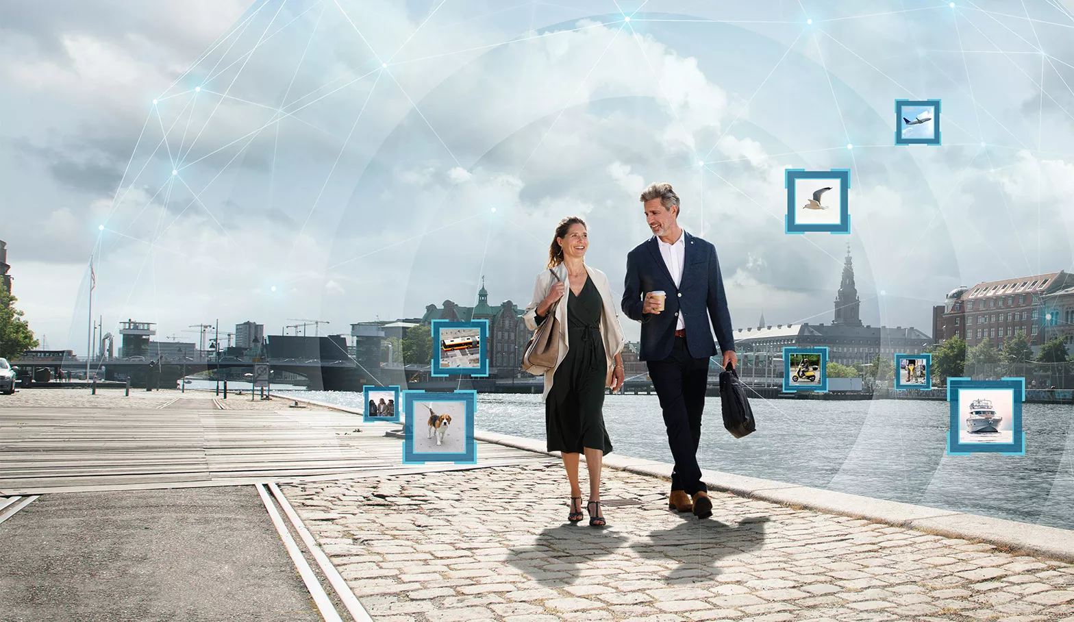 Oticon technology demonstrated with a couple walking through a city