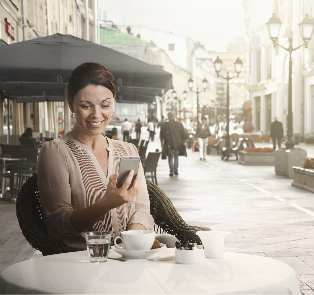 woman outside with smartphone