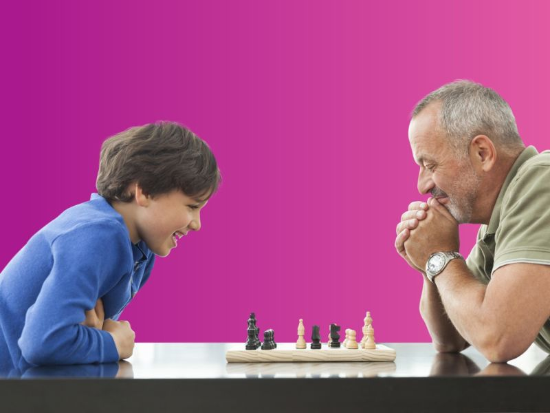 Man and child playing chess