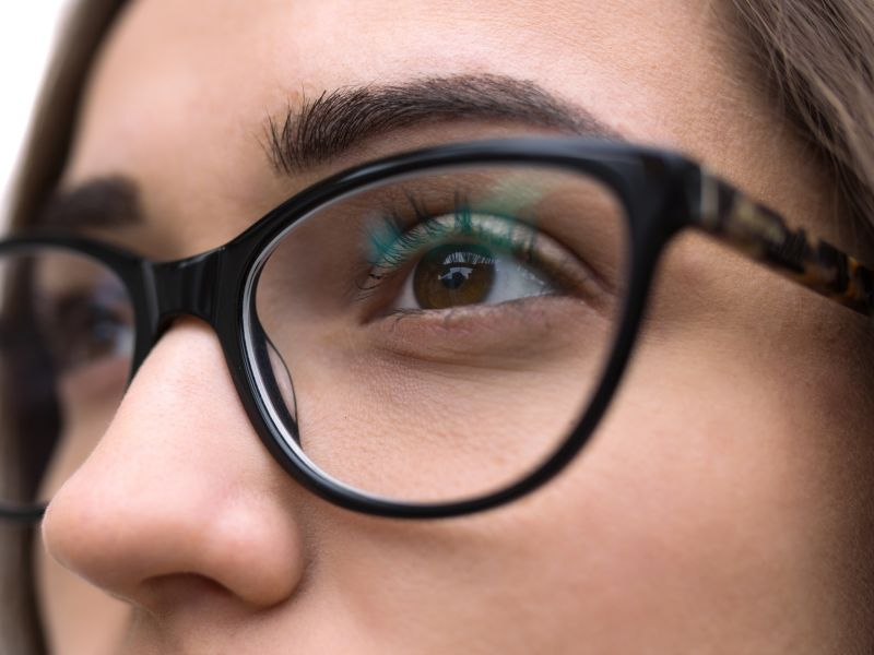 Close up of woman wearing glasses