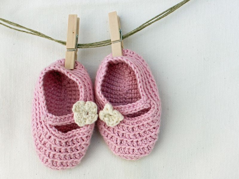 Pair of knitted pink baby shoes