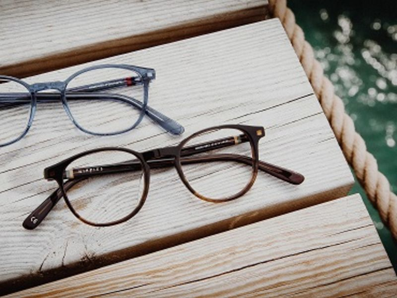 Two pairs of glasses on wood