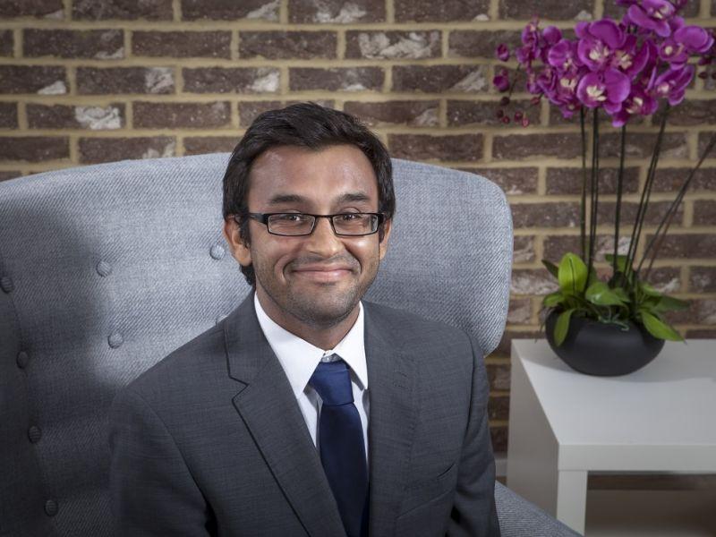 Ashish Shah sat down smiling at camera