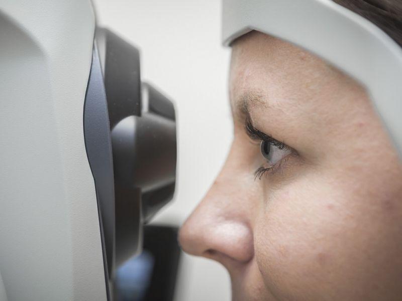 Woman having a digital eye photograph taken