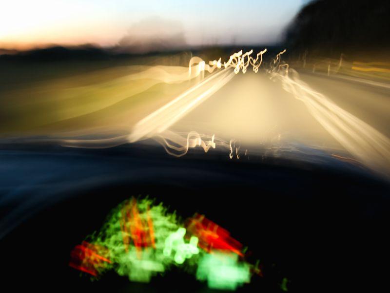 Blurry car dashboard on road
