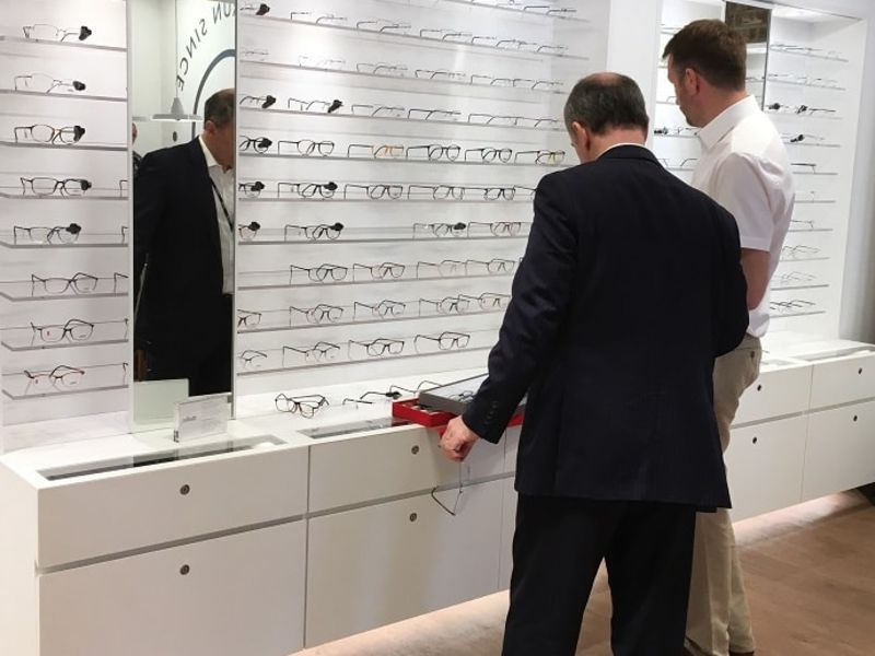 Two men checking out glasses