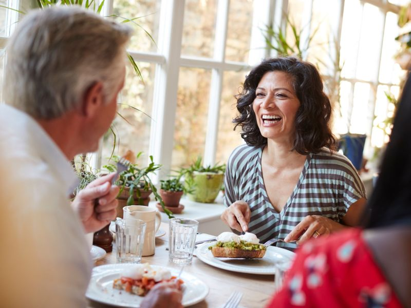 hearing aid wearer laughing at lunch