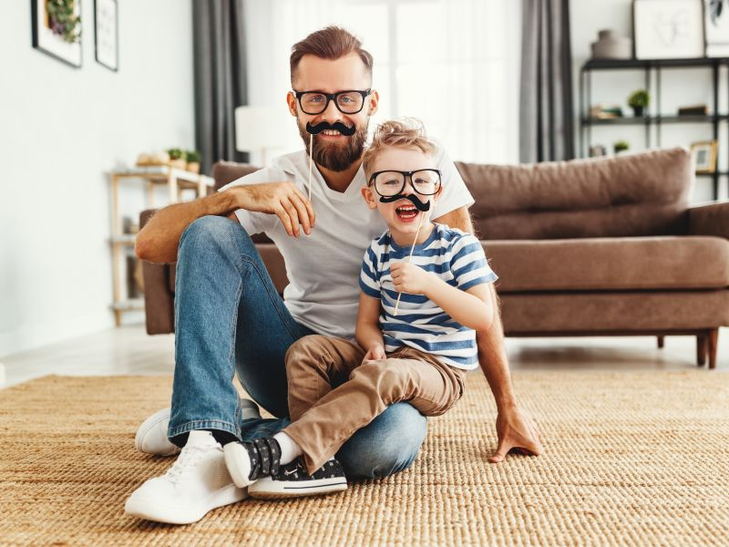 Father and son trying on the glasses to watch out for