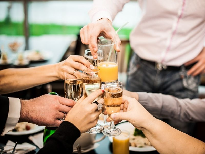 Group of people clinking prosecco glasses