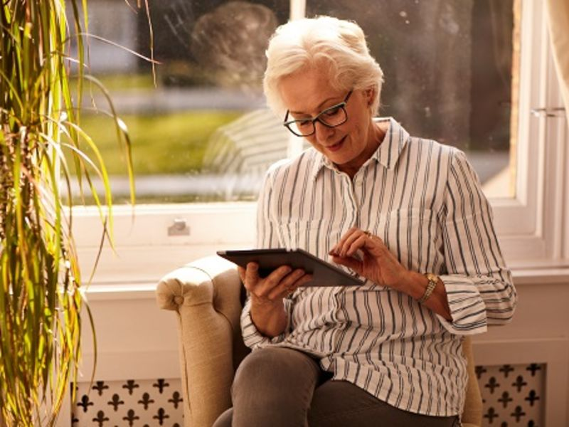 Woman sat down using Ipad