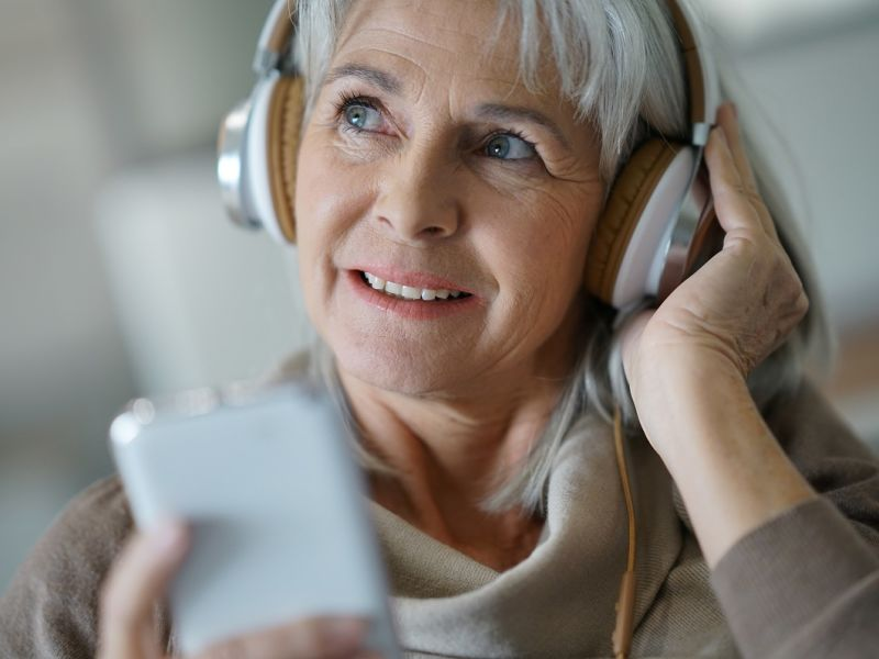 Woman wearing headphones listening to audio