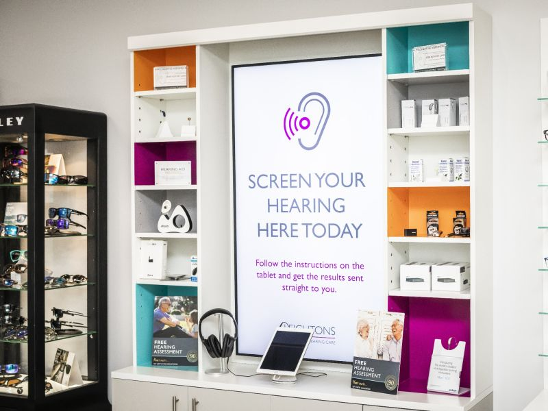 """Screen Your Hearing Here today"" poster in practice"