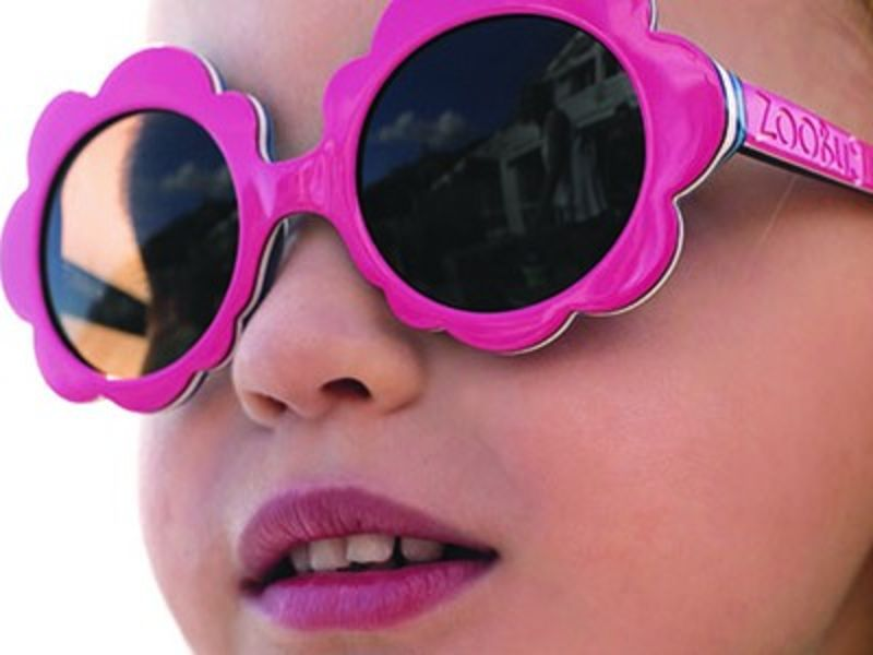 Young girl wearing pink sunglasses