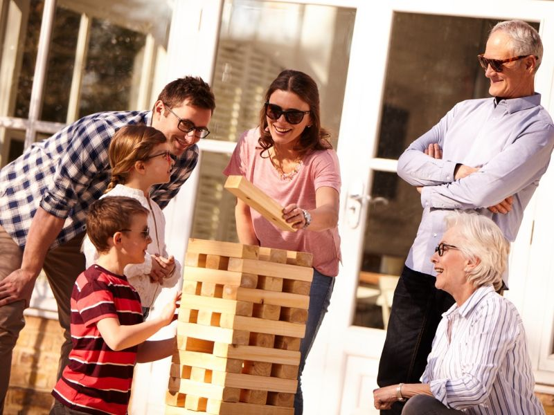 Three generation family playing Jenga