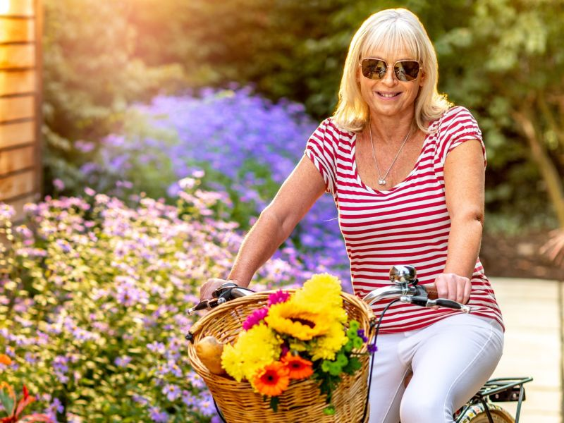 Woman on a bike wearing sunglasses