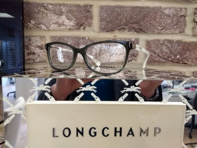 Longchamp glasses on mirrored surface