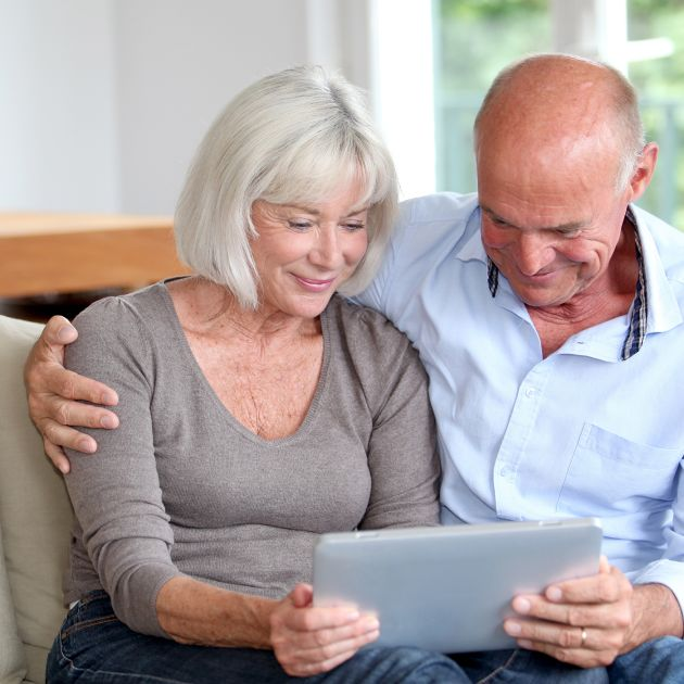 couple looking at a tablet