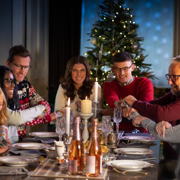 Family around the dinner table at Christmas