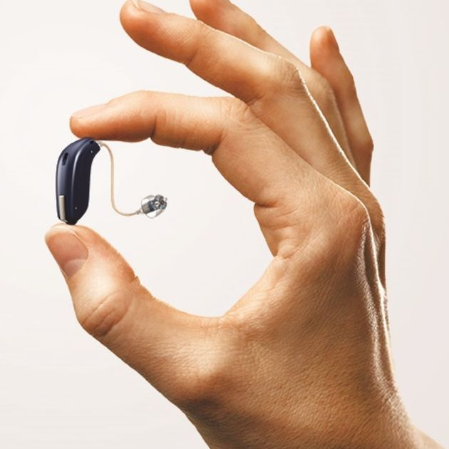 opn hearing aid in hand