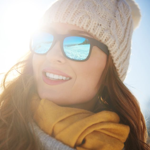 Woman in winter sunglasses
