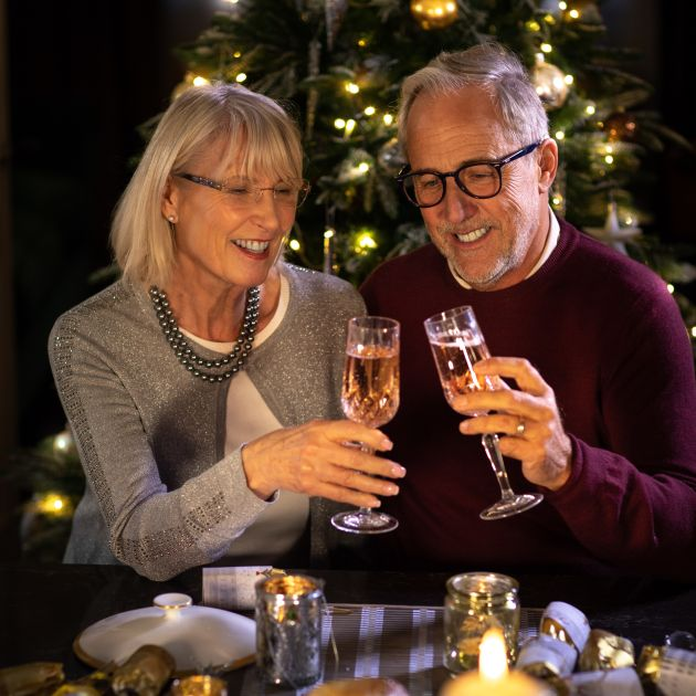 husband and wife champagne toast christmas