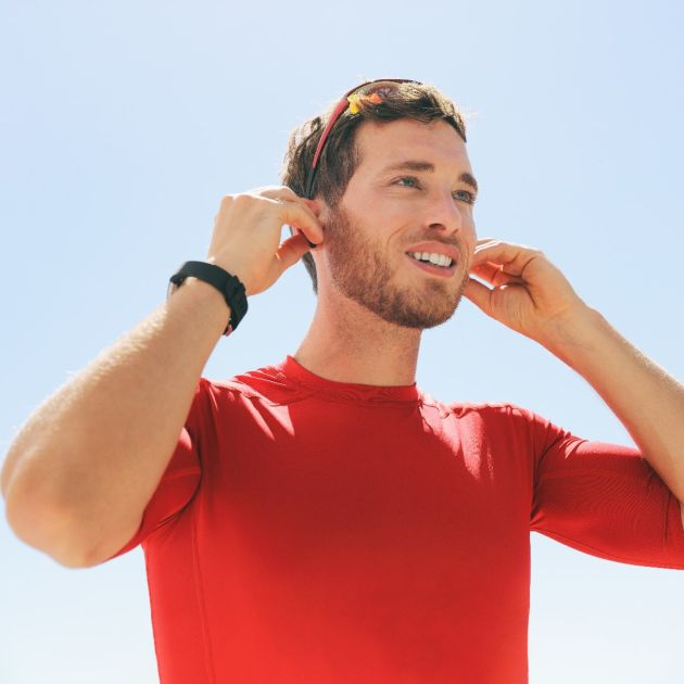Man ready for a run with hearing aids