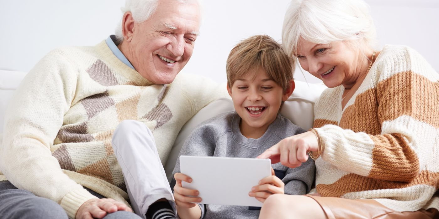 Grandparents with grandchild on ipad