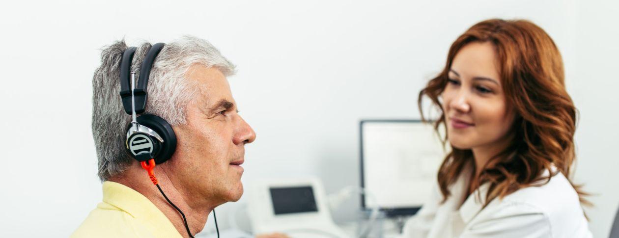 senior gentleman having a hearing test