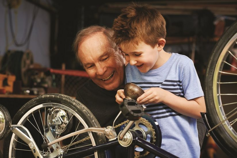 grandfather and child fixing bicycle