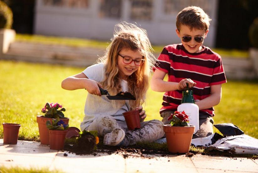 children playing in sunny garden