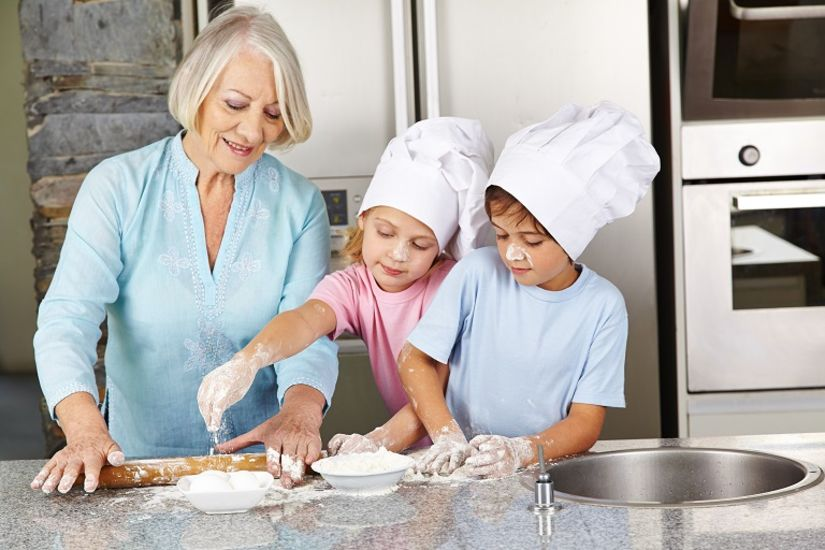 children and grandmother baking