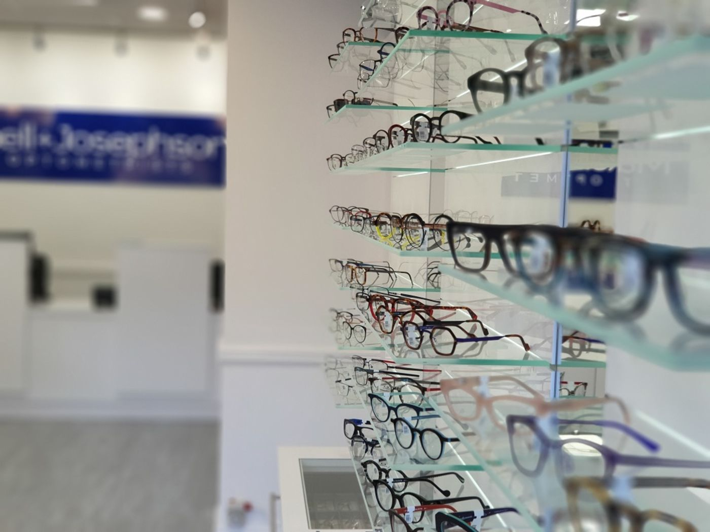 Blurred image of glasses on display in opticians