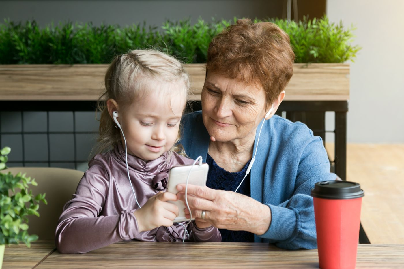 girl and grandma using headphones