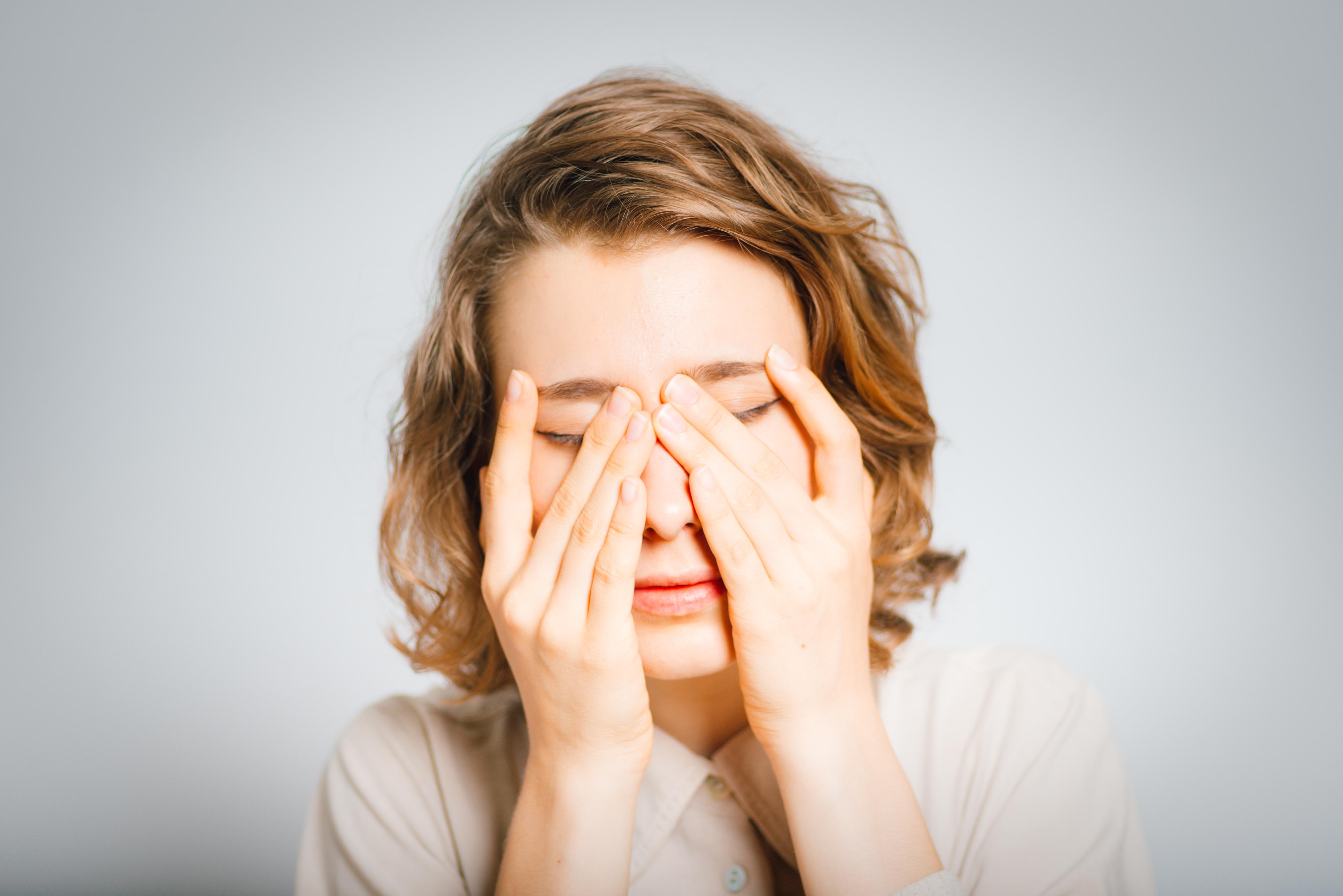 person rubbing uncomfortable eyes