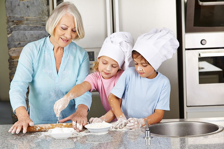 children and grandmother baking