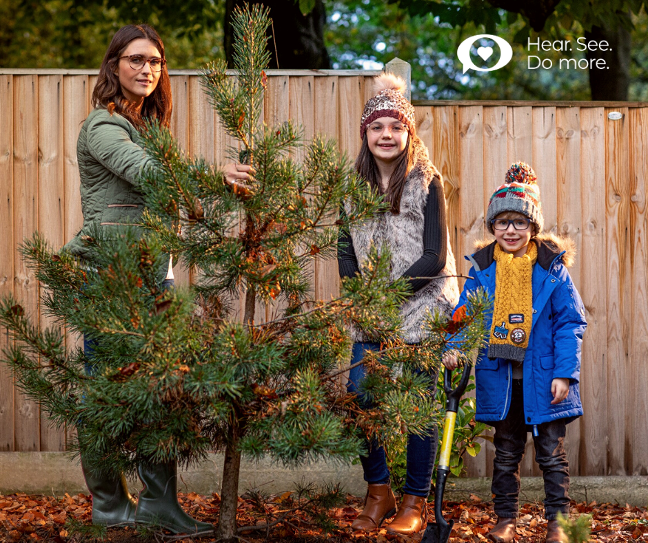 family planting a tree in winter