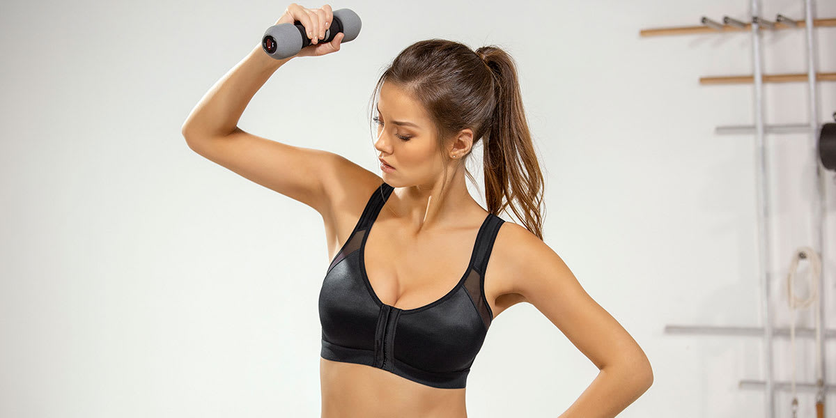 woman working out in posture corrector bra - Leonisa