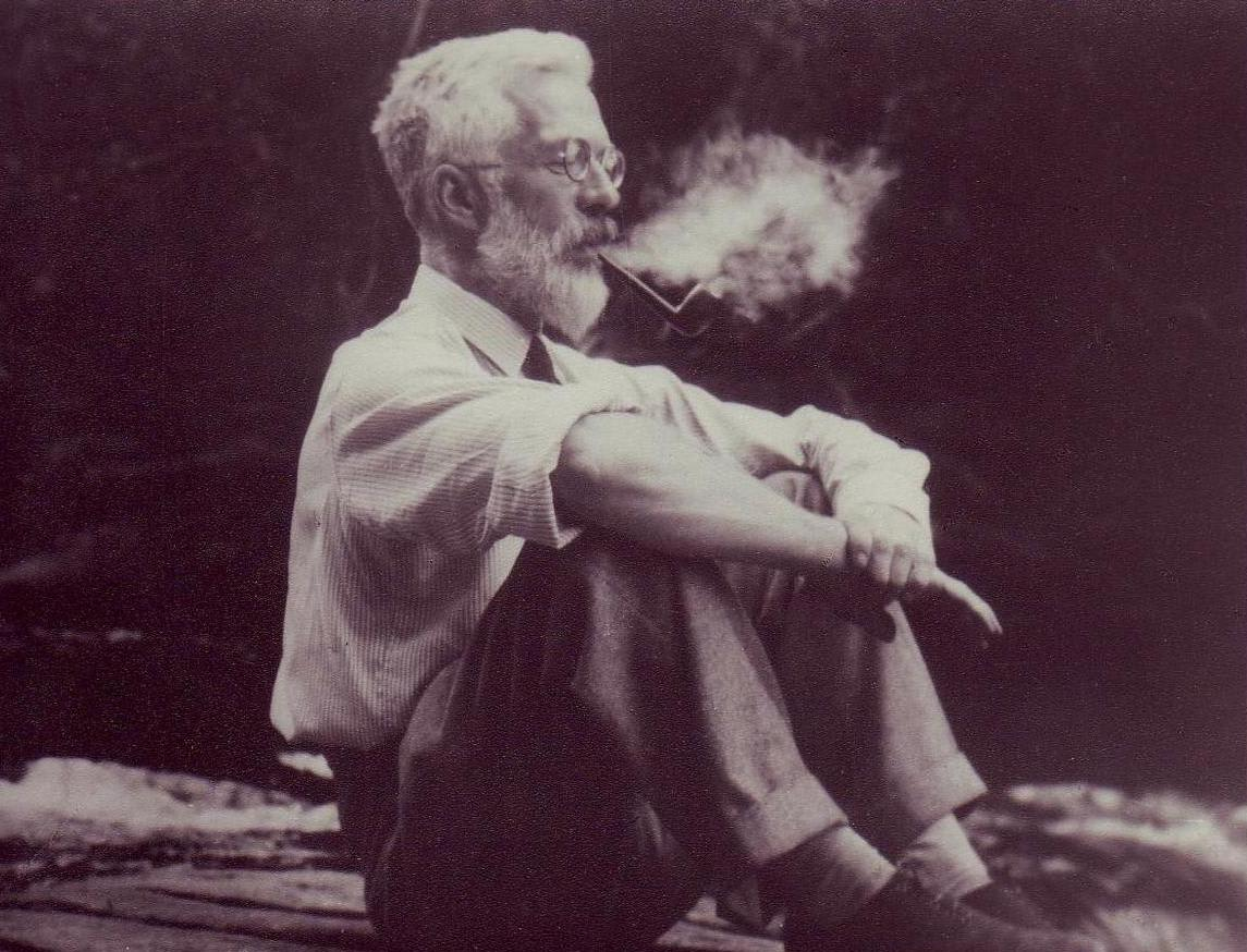 Picture of Ronald Fisher sitting and smoking