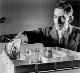 Image of Claude Shannon conducting an experiment on mice