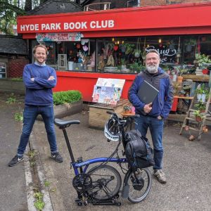 Stuart Clarke from Leeds Digital Festival donating laptops to DAWY at Hyde Park Book Club