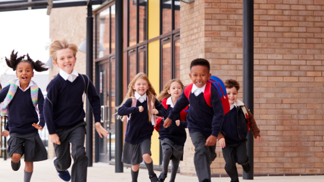 Kids running in school uniform