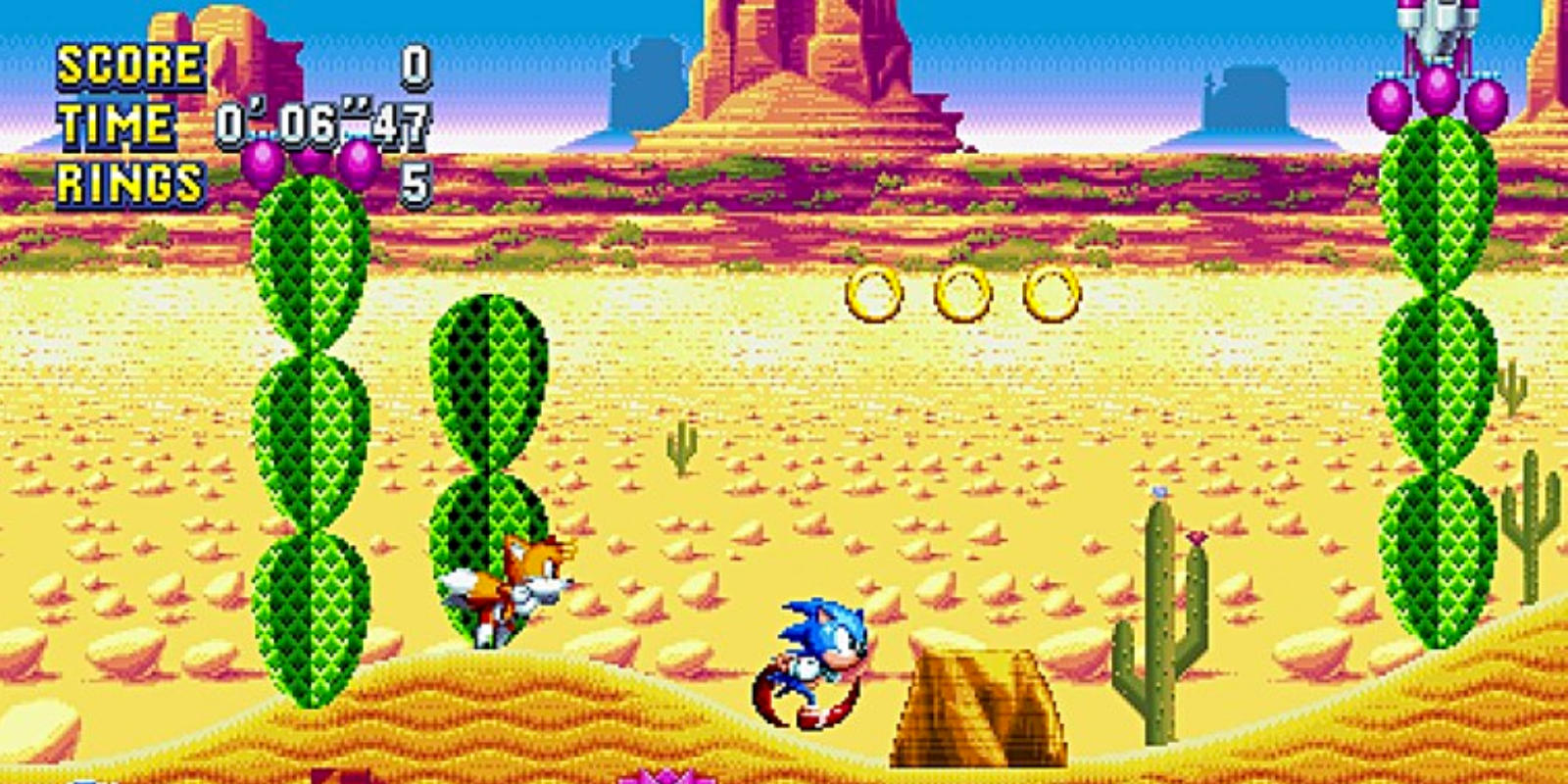 Sonic and Tails dash through the rocky desert in Mirage Saloon Zone