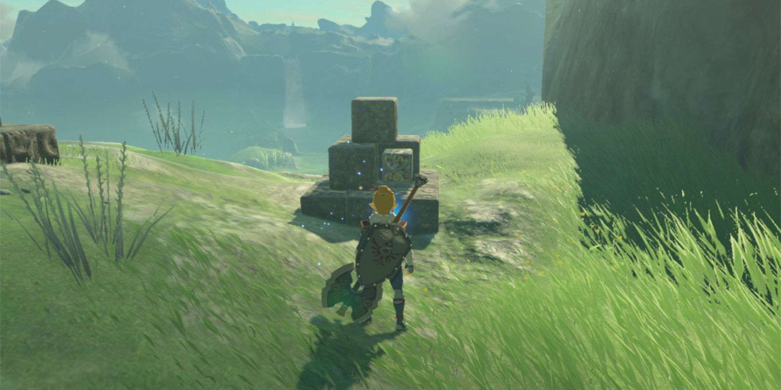 Link, carrying a large battle axe, solves a stacking-block puzzle by placing an iron cube in the correct position between other stone cubes.