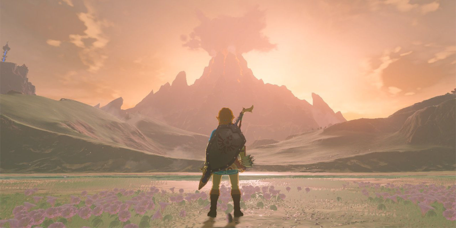 The sun sets behind the distant Death Mountain, and Link's body is silhouette against the fading, coral light of the sun.