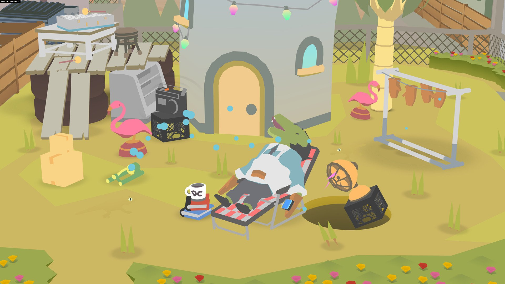 In Donut County, you control a hole in the ground that grows as it swallows parts of the environment. Pictured is a particularly messy lawn, belonging to a crocodile that wears oven mitts (at all times). Scattered about are more oven mitts, a sprinkler, old tires, lumber, books, and more.